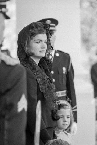 Jackie leaves The White House during funeral