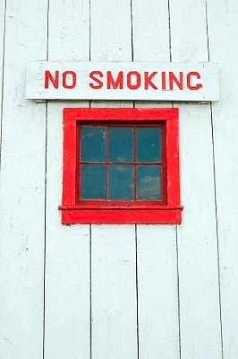 A sign above a window.