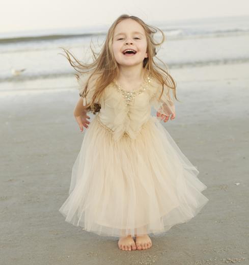Girl in princess dress at the beach