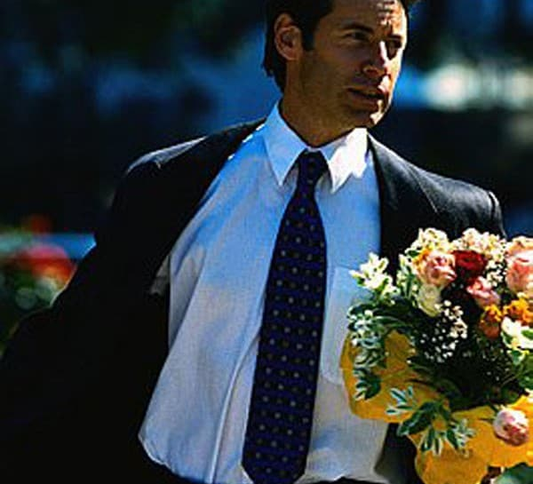 Businessman Carrying Bouquet