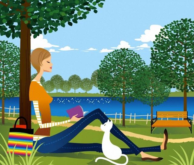 Woman sitting under tree, reading book