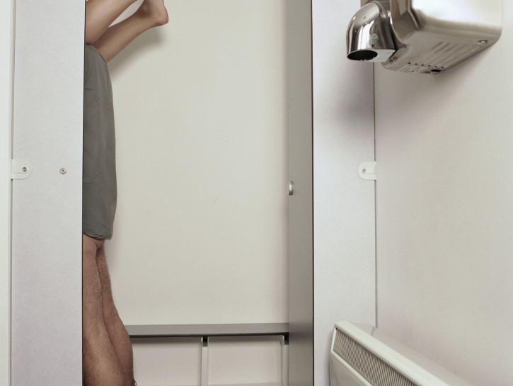 Couple Having Sex in Bathroom Stall