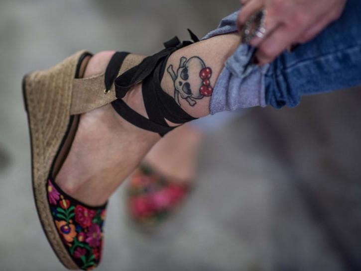 Tatuaggio caviglia donna