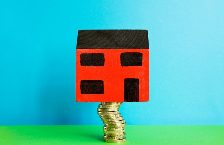 Toy house on one pound coins